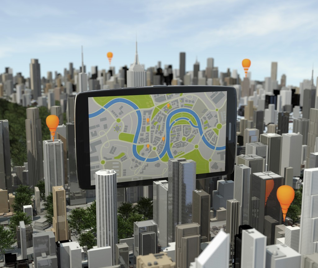 smartphone with navigator over city with ibeacons